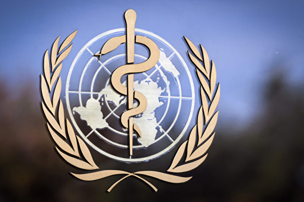 Логотип Всемирной организации здравоохранения (ВОЗ) на фасаде штаб-квартиры ВОЗ в Женеве, 24 октября 2017 года